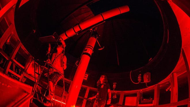 Red is the light used around the Kopernik Observatory's telescopes, to mimic the total darkness needed to see planetary bodies.