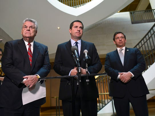 House Intelligence Chairman Devin Nunes, standing with