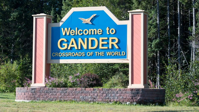 """A large sign welcomes drivers to the town of Gander, dubbed the """"Crossroads of the World."""""""