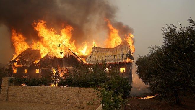 Fire consumes a barn as a wildfire moves through Glen Ellen, Calif. Oct. 9, 2017.