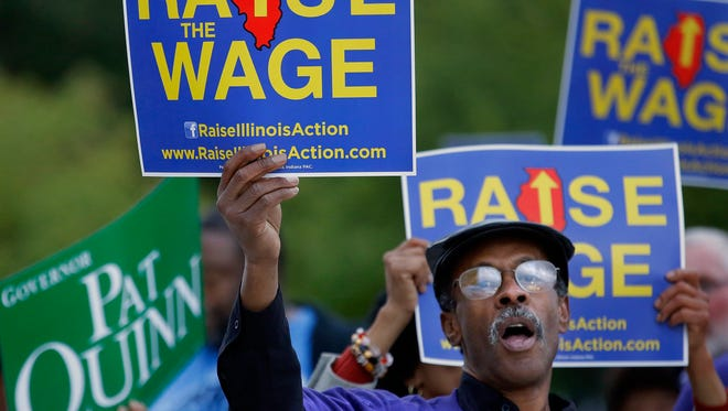 Supporters of raising the minimum wage rally in Peoria, Ill., in September.