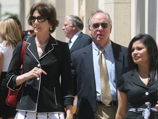 Melissa O'Rourke, left, and supporters left the U.S.