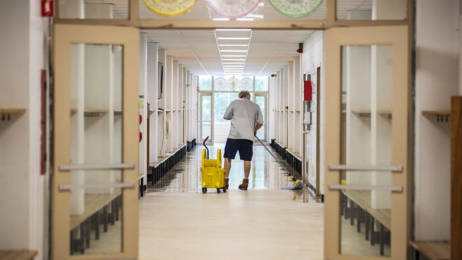 Mike Russell, head custodian of the Woodsdale Elementary School in Abington, waxes the floors on Monday, Aug. 3, 2020. Russell, who has been working at the Woodsdale school since 2004, is preparing for students to return in September with new safety guidelines amid the coronavirus pandemic.
