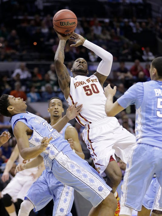 Iowa State's DeAndre Kane (50) shoots over North Carolina's Isaiah Hicks (22) during the first half of a third-round game in the NCAA college basketball tournament Sunday, March 23, 2014, in San Antonio. (AP Photo/Eric Gay)