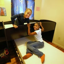 Rayshawn Allen, 5, was excited as the Morris Home Furnishing truck pulled up with a bunk bed for his cousin Jalisa Allen, 10, and him.