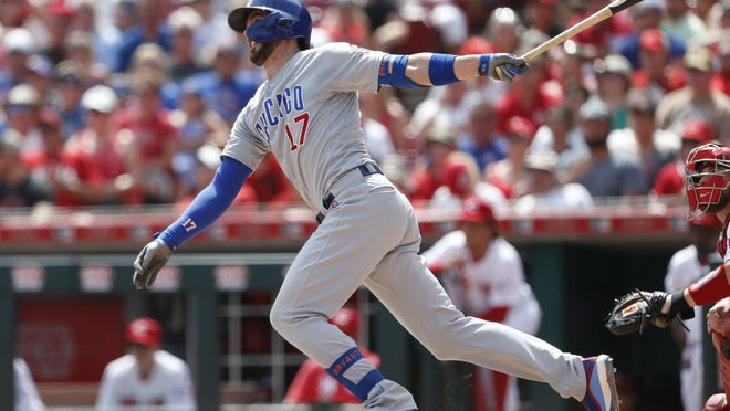 Chicago Cubs' Kris Bryant (17) follows through on a three-run home run off Cincinnati Reds relief pitcher Michael Lorenzen during the seventh inning of a game on Sunday, Aug. 11, 2019, in Cincinnati.