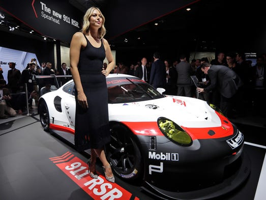 Tennis star Maria Sharapova poses with the 2017 Porsche