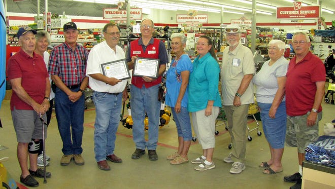 """Board members for the Southwestern New Mexico Transition Center presented Ben Lucas, manager of the Deming Tractor Supply Co. Store, with a certificate of appreciation. Lucas allowed the SWNMTC to sell raffle tickets in front of the sotre to help the """"Veterans Helping Veterans"""" group raise money through a quilt drawing. The SWNMTC served all veterans in the community and the tri-county area (Hidalgo, Luna and Grant) by providing a food bank distribution once a month and assisting all veterans in obtaining services they are entitled to. Pictured from left are John Pace, Jacki and Bill Crosby, Terry Kline, Lucas, Bobbi Widick, Cabrini Martinez, Ron Sease, Judith Stanfield and Richard Dellamaestor."""