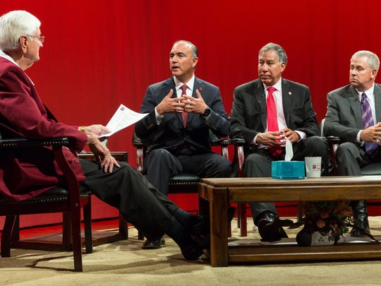 New Mexico State University president Garrey Carruthers, far left, hosts a Domenici Institute Public Policy Forum on Friday, Sept.9, 2016, at the KRWG-TV studio with Mexico Secretary of Agriculture José Eduardo Calzada Rovirosa, left,  U.S. Department of Agriculture Under Secretary, Marketing and Regulatory Programs, Edward Avalos, center, and New Mexico's Secretary of Agriculture Jeff Witte.