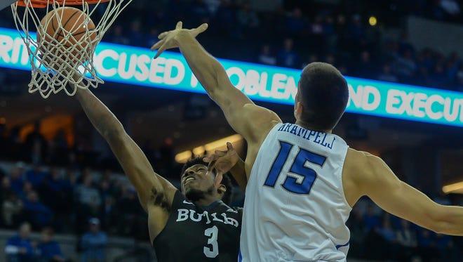 Butler Bulldogs guard Kamar Baldwin (3) drives to the basket against Creighton Bluejays forward Martin Krampelj (15) during the first half at CenturyLink Center Omaha.