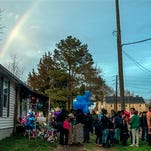 In this Friday, April 10, 2015 photo, mourners gather for a prayer vigil at the residence of Rodney Todd and his seven children found dead April 6, 2015, the result of accidental carbon monoxide poisoning at their home, police said. Next week, the Princess Anne Fire Department, Somerset County Board of Education and area agencies launch a carbon monoxide education awareness project in county public schools.