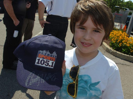Quinn Pascoe, 7, shows off a signed autograph by Rusty Wallace.