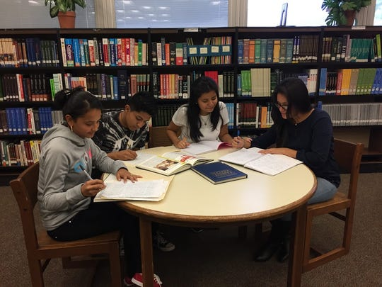 ESL elementary students receive small group instruction