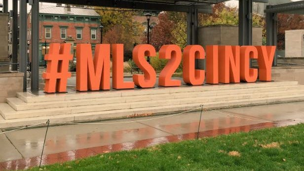 """An """"#MLS2CINCY"""" installment at Washington Park appeared Monday in preparation of Tuesday visit to the city by Major League Soccer Commissioner Don Garber."""