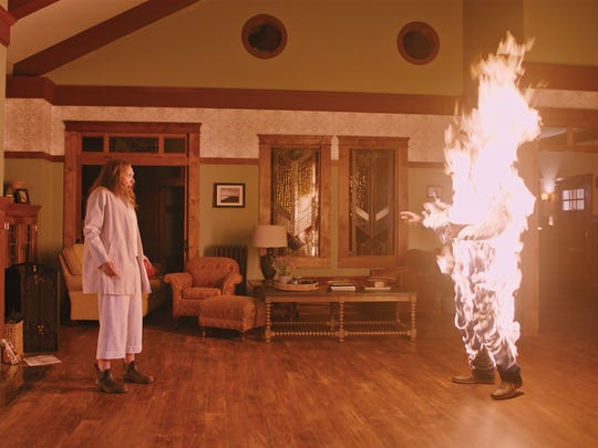 "Annie's (Toni Collette) family quite literally bursts into flames in a nightmarish scene from ""Hereditary."""