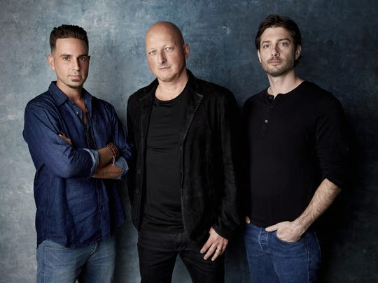 "Wade Robson, left, director Dan Reed and James Safechuck pose for a portrait to promote the film ""Leaving Neverland"" at the Salesforce Music Lodge during the Sundance Film Festival in Park City, Utah."