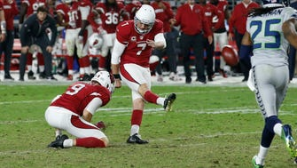 Arizona Cardinals kicker Chandler Catanzaro (7) kicks a field goal as punter Ryan Quigley (9) holds during overtime of a football game against the Seattle Seahawks, Sunday, Oct. 23, 2016, in Glendale, Ariz.