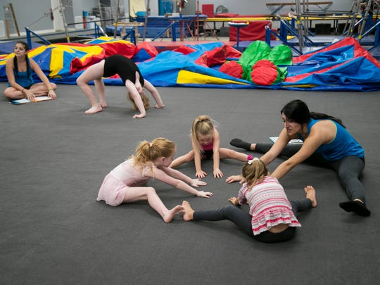 Annie Presitgiacomo, right, leads a preschool class in a warmup on Monday, November 7, 2017, at Gymnastic World in south Fort Myers.