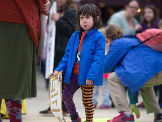 Lula Shelton-Oyler, 4, of Knoxville makes a face while