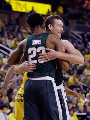 Matt Costello hugs teammate Deyonta Davis during the second half of MSU's win Saturday at Michigan. Costello and Davis have each developed into essential players on MSU's team.