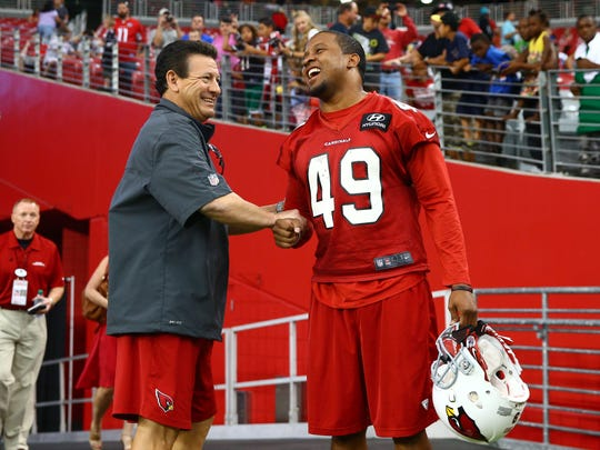 Cardinals safety Rashad Johnson (right) with defensive backs coach Nick Rapone.
