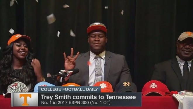 Ashley Smith (left) watches as her brother, Trey, commits to Tennessee.