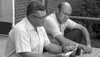 Green Bay Packers personnel director Pat Peppler, right, sits with coach Vince Lombardi outside a building at St. Norbert College in De Pere as training camp begins in July 1964. Peppler died Tuesday at 93.