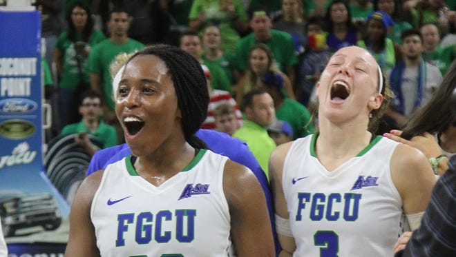 DyTiesha Dunson and Katie Meador of the FGCU Women's basketball team, celebrate after defeating Michigan in the WNIT semifinals at Alico Arena on Thursday night.