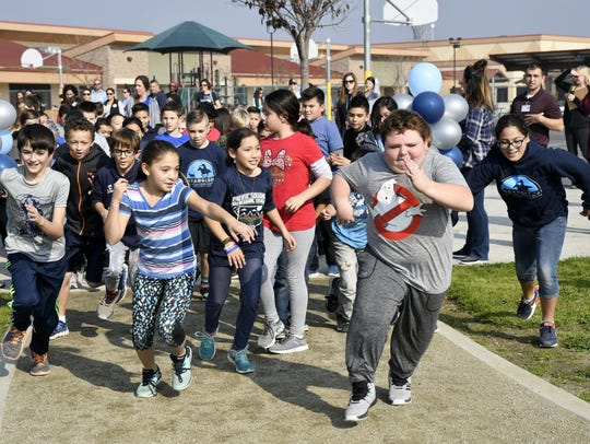 Shannon Ranch Elementary School students go for a run