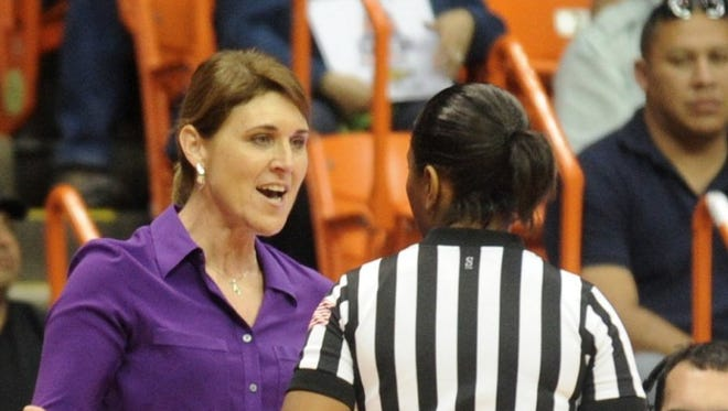 Abilene Christian coach Julie Goodenough, left, argues a call with an official during the second half against Texas-El Paso. UTEP beat the Wildcats 66-62 in the first-round WNIT game on Thursday, March 17, 2016 at the Don Haskins Center in El Paso.