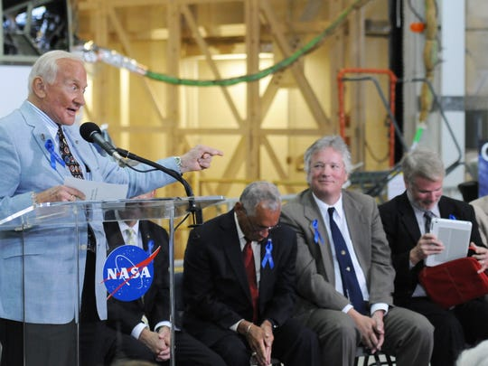 Buzz Aldrin makes a joke on stage with Robert Cabana; Charles Bolden; Neil Armstrong's sons, Rick and Mark; and Jim Lovell.