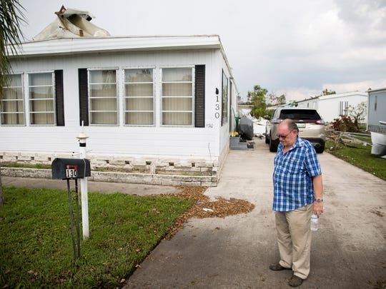 Ed Pearson, 78, stands outside his home in Naples Estates,