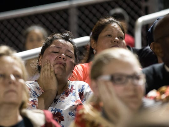 A women wipes way tears during a prayer vigil for the victims of the Sutherland Springs First Baptist Church shooting at Floresville high school stadium on Nov. 7, 2017.