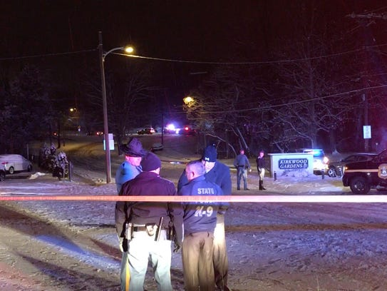 Officers on Farrand Drive hold the scene while others
