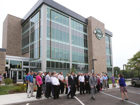 A crowd gathered in front of the building for the ceremony. A ribbon cutting ceremony and open house officially opened the new $6.2-million Greenwood City Center at 300 S. Madison Avenue Thursday August 7, 2014.