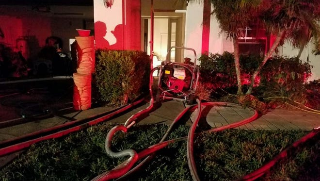 Firefighters battle a house fire Saturday night in Suntree.