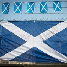 EDINBURGH, SCOTLAND - SEPTEMBER 11:  Yes supporters flags are displayed besides a block of flats on Leith Walk on September 11, 2014 in Edinburgh, Scotland. Voters will go to the polls a week today to decide whether Scotland should become an independent country and leave the United Kingdom.  (Photo by Matt Cardy/Getty Images)
