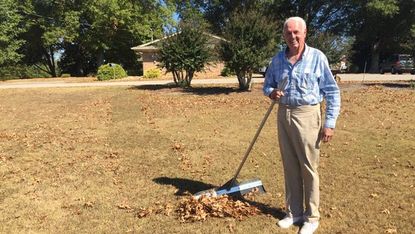 Larry Gibson with his invention, the LeafComb Rake.