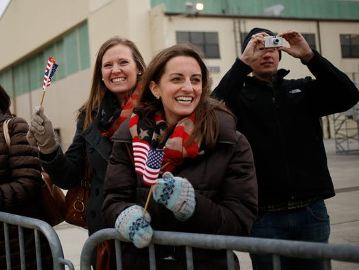 Caitlin Miller, at right, smiles as a charter plane