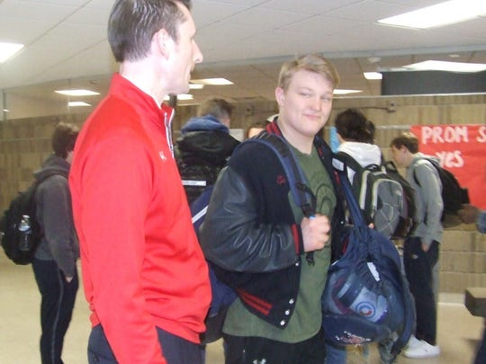 Principal Andrew Pesci has a friendly word with sophomore Jake Swirple during a class exchange on Jan. 19.
