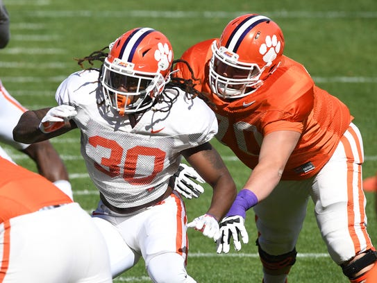 Clemson offensive lineman Seth Penner (70) tries to