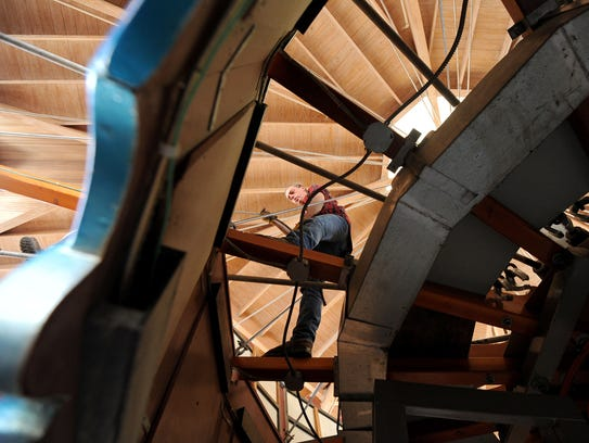 Tom Iverson of Marion works on repairs on the carrousel