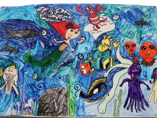 """A drawing of """"The Little Mermaid"""" hangs at a fairy"""