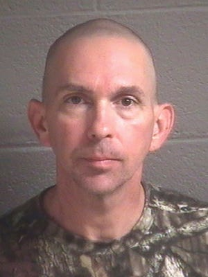 This undated photo provided by the Buncombe County (N.C.) Detention Center shows Michael Christopher Estes, who's accused of planting an improvised explosive device at the airport on Friday, Oct. 6, 2017, in Asheville, N.C. A criminal complaint in federal court accuses Estes of attempted malicious use of explosive materials and unlawful possession of explosives at the airport.