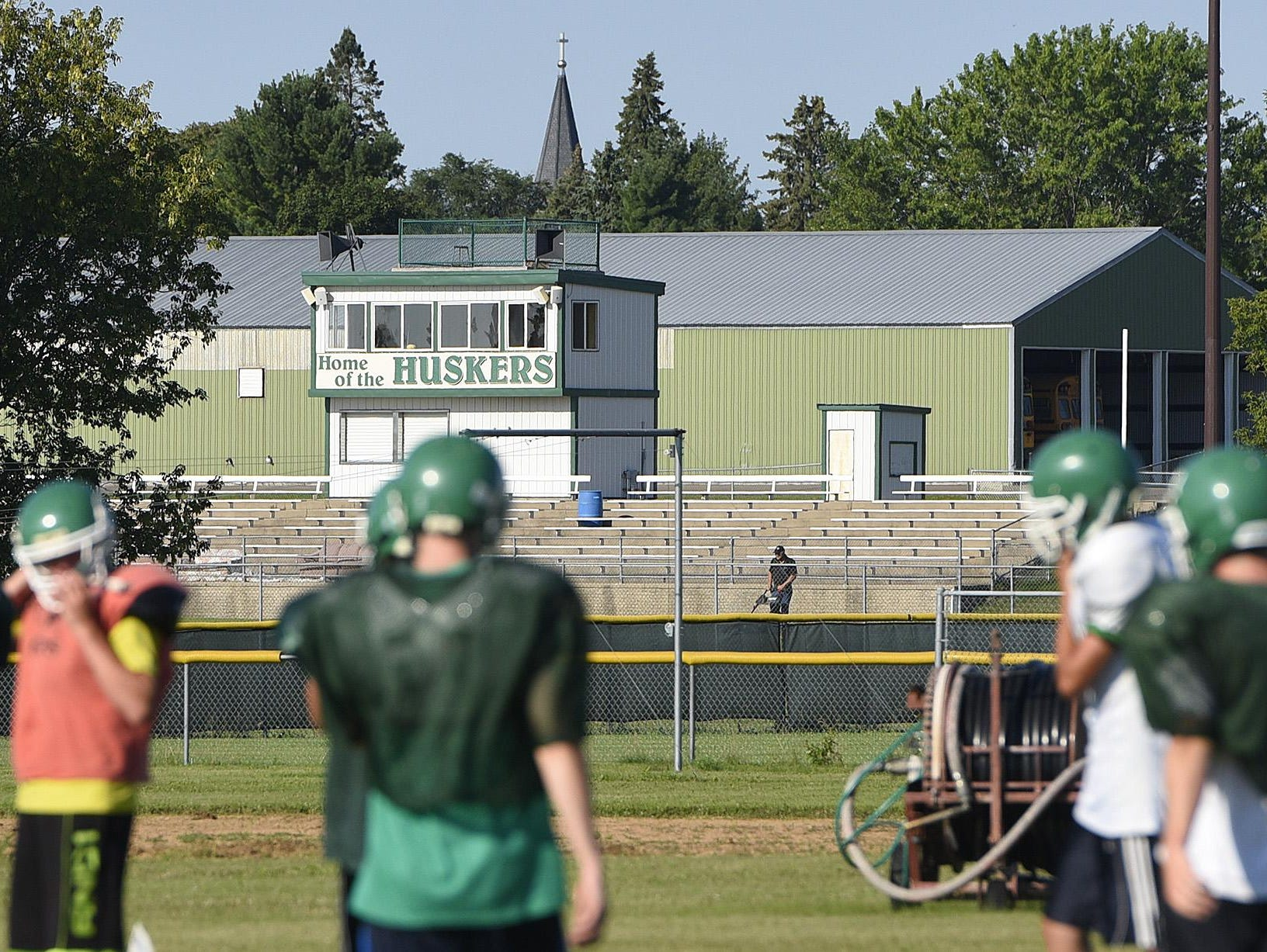 Holdingford's football field is shown behind players on their practice field Wednesday during practice in Holdingford.