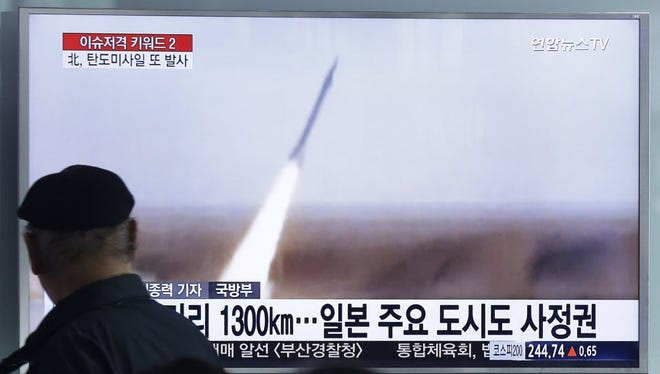 Footage of a missile launch by North Korea on a TV in Seoul on March 18, 2016.