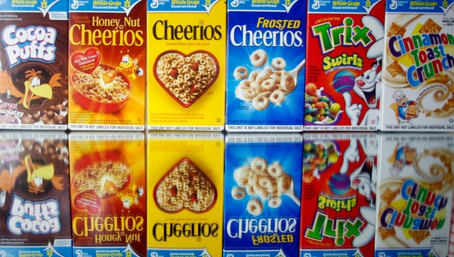 This March 22, 2011 file photo shows boxes of General Mills cereals in Portland, Ore.