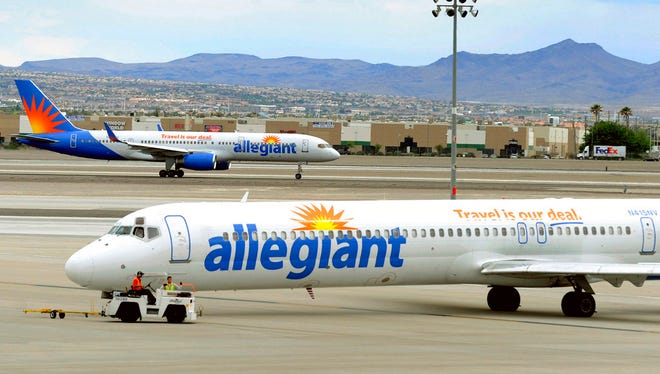 "In this May 9, 2013, file photo, two Allegiant Air jets taxi at McCarran International Airport in Las Vegas. Shares of Allegiant Air's parent company are tumbling in Monday, April 16, 2018, premarket trading following a ""60 Minutes"" investigation that expressed serious safety concerns about the airline."