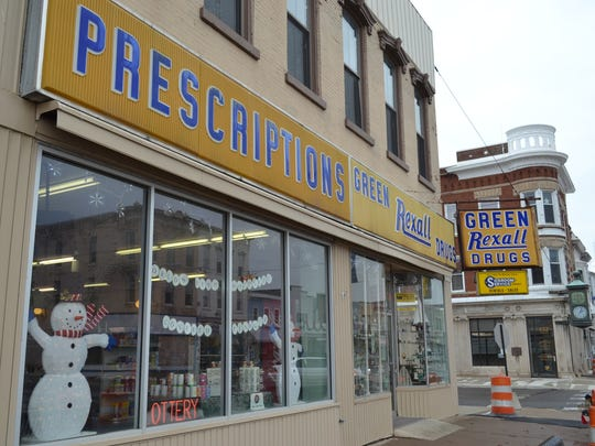 "Green's Pharmacy still sports the vintage ""Green Rexall Drug"" sign first hung decades ago. The Green Pharmacy building has been a drug store since 1872."