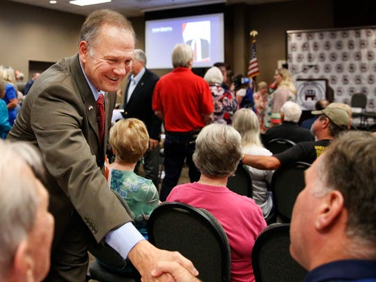 Roy Moore, talks to constituents before a Republican